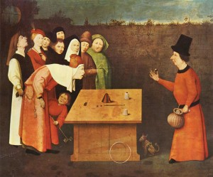The Conjurer by Hieronymus Bosch, 1502.  Note that the person in front is having his wallet stolen as the magician performs a trick of balls and cups.