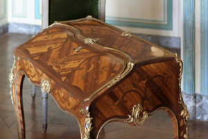 A beautiful piece of shellacked furniture at the Palace of Versailles in Paris