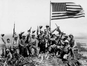 Raising the American flag on Mt. Suribachi in Iwo Jima during World War II.