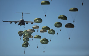 U.S. Army paratroopers from the 82nd Airborne Division descend to the ground after jumping out of a C-17 Globemaster III aircraft
