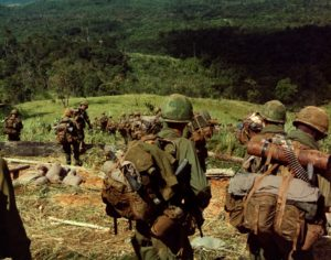 Members of Co. C, 1st Bn, 8th Inf, 1st Bde, 4th Inf Div, descend the side of Hill 742, located five miles northwest of Dak To. 14–17 November 1967.