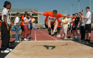 070422-N-5215E-003 ANNAPOLIS, Md. (April 22, 2007) - A Special Olympics athlete participates in the long jump at the Naval Academy. This was the 39th year the Academy hosted the event, which drew 175 athletes from the surrounding area for two days of aquatics and track and field competition. More than 300 Midshipmen, active duty service members, and Annapolis-area high school students volunteered as event staff and athlete escorts for the event. U.S. Navy photo by Mass Communication Specialist Seaman Apprentice Matthew A. Ebarb (RELEASED)