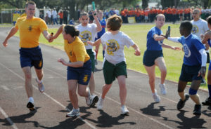 U.S. Navy Junior Reserve Officer Training Course (NJROTC) cadets hand off batons during a 8x220-yard relay race on Naval Air Station Pensacola, Fla., April 17, 2009, during the 2009 NJROTC National Academic, Athletic and Drill competition. Units from 25 high schools, in 13 states, competed in personnel inspections, academic tests, military drill, and athletic events. (U.S. Navy photo by Scott A. Thornbloom/Released)